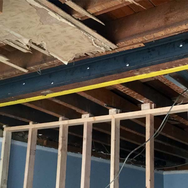 Steel and wood beam repair in basement.